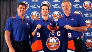 New Islanders captain John Tavares poses for a photo with coach Jack Capuano and GM Garth Snow. nhl.com