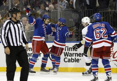 Brian Boyle celebrates his first goal with Brad Richards. AP Photo/Kathy Willens