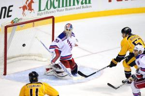 Cam Talbot gets a piece of Gabriel Bourque's shot en route to a 17-save shutout over the Predators. He improved to 5-1-0 with 2 shutouts all on the road.  AP Photo/Mike Strasinger