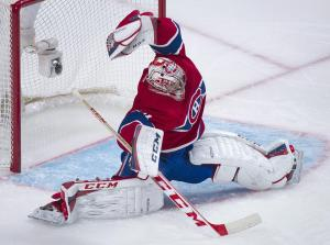 Canadien goalie Carey Price (33 saves) makes a glove save. The Rangers solved him once and finally got a win in Montreal. The Canadian Press/Graham Hughes
