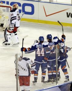 Brock Nelson is congratulated by teammates including Calvin de Haan for his goal.  Getty Images/Frank Franklin II