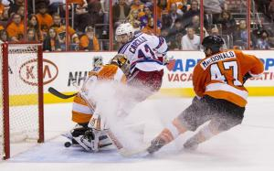Car Bombed: Daniel Carcillo watches his redirection slip past Ray Emery for the knockout blow highlighting a Rangers 4-1 Game 3 win over the Flyers. AP Photo/Chris Szagola