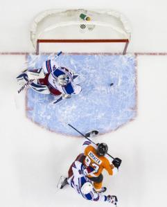 Jakub Voracek tips in the winner on the power play that evened the series.  AP Photo/Chris Szagola