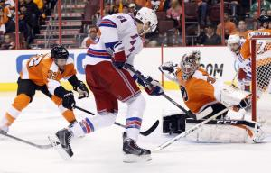 Steve Mason denies Rick Nash for one of his 37 saves.  AP Photo/Chris Szagola