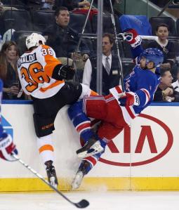 Flyers forward Zac Rinaldo delivers a big hit on Rangers defenseman Kevin Klein in Game 1.  AP Photo/Bruce Bennett