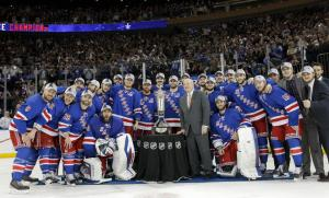 Eastern Conference Champions: An excited group of Rangers pose with the Prince of Wales Trophy after defeating the Canadiens to reach the Stanley Cup Finals. AP Photo/Kathy Willens