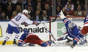 Hen-rik: Henrik Lundqvist makes an incredible save to rob Thomas Vanek. AP Photo/Kathy Willens