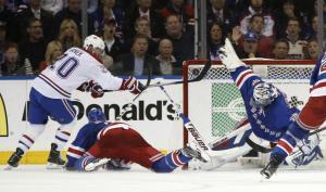 Hen-rik: Henrik Lundqvist makes an incredible save to rob Thomas Vanek. AP Photo/Kathy Willens
