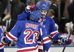 Dominic Moore is congratulated by Brian Boyle after his series clinching goal in the second period. AP Photo/Kathy Willens