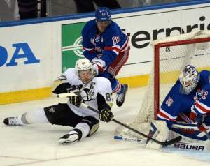 Marc Staal checks Sidney Crosby from behind in Game 3.  Tribune Review/Chaz Palla