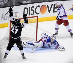 Stanley Cup hero Alec Martinez celebrates the clinching goal in double overtime. The Kings took the series in five games with three needing sudden death including last night's Stanley Cup classic. AP Photo/Mark J. Terrill