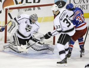 Jonathan Quick makes a save on Mats Zuccarello during his 32-save Game 3 shutout of the Rangers in the 2014 Stanley Cup Final. After missing the postseason, the Kings are banking on new addition Milan Lucic to bring them back in a loaded West. AP Photo/Frank Franklin II