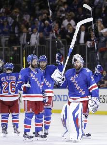 Henrik Lundqvist and teammates salute the crowd following their 2-1 Game 4 win over the Kings.  AP Photo/Seth Wenig