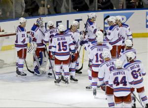 Happy teammates congratulate Cam Talbot on his shutout.  AP Photo by Frank Franklin II/Getty Images