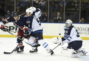 Tanner Glass battles Mark Stuart during last night's Rangers loss to Winnipeg. Getty Images/Photo by Kathy Kmonicek