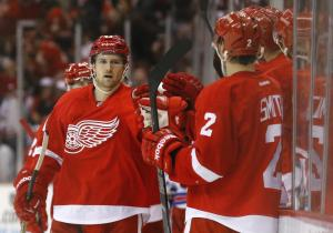 Darren Helm gets congrats from Brendan Smith after scoring the game-winner in Detroit's 3-2 win over the Rangers.  AP Photo by Paul Sancya/Getty Images