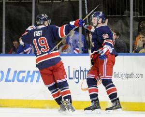 The Kids Are Alright: Jesper Fast congratulates J.T. Miller on his goal during the Rangers' 5-2 win over the Flyers.  AP Photo by Bill Kostroun/Getty Images