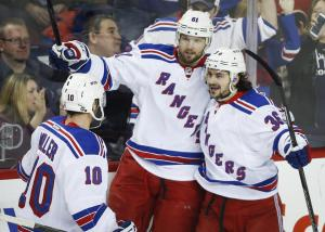 Nashty Boy: Rick Nash (center) is congratulated by J.T. Miller (left) and Mats Zuccarello (right) after scoring another goal.  AP Photo by Jeff McIntosh/The Canadian Press