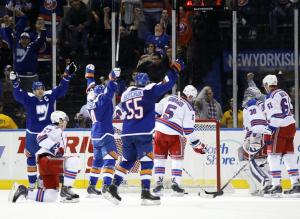 Islanders Celebrate: The Islanders celebrate Mikhail Grabovski's goal in the first. AP Photo by Kathy Willens/Getty Images
