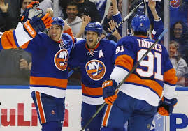 Kyle Okposo (inset) celebrating a 4-goal performance will miss 6 to 8 weeks for the division-leading Islanders. Getty Images