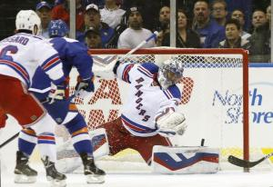 Henrik Lundqvist is all alone as the Islanders score in their latest win. AP Photo by Kathy Willens/Getty Images