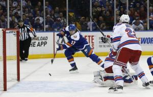 Matt Martin puts away a goal in another dominant Islanders' win over the Rangers.  AP Photo by Kathy Willens/Getty Images