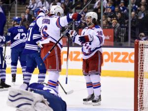 Zucc's Back: A happy Mats Zuccarello gets congrats from Derick Brassard for one of his two goals in the Rangers' 5-4 win over the Leafs.  The Canadian Press by Frank Gunn