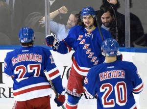 Zucc Celebrates: Mats Zuccarello is congratulated by Ryan McDonagh and Chris Kreider after his goal.  AP Photo by Bill Kostroun/Getty Images