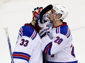 Kiss Cam: Chris Kreider kisses Cam Talbot's helmet following his 28-save performance in the Rangers' 3-1 win that moved them into first.  AP Photo by Alex Brandon/Getty Images