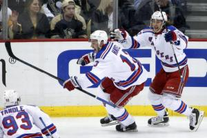 OT Hero: Kevin Hayes celebrates his OT winner with Carl Hagelin and Keith Yandle. AP Photo by Gene J. Puskar/Getty Images