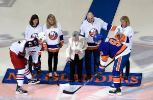 Claire Arbour drops the ceremonial puck before the Islanders' final regular season home game between John Tavares and Scott Hartnell. AP Photo by Kathy Kmonicek/Getty Images