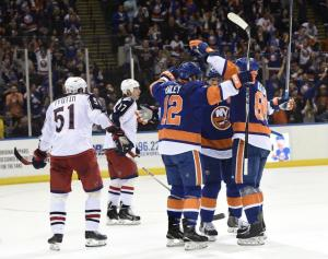 Kyle Okposo celebrates his goal with teammates Josh Bailey and Nikolay Kulemin. AP Photo by Kathy Kmonicek/Getty Images
