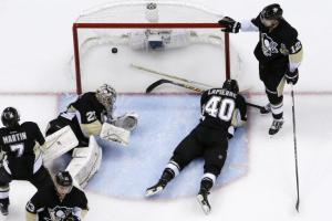 Marc-Andre Fleury can only watch along with fallen teammates as Kevin Hayes scores the OT winner. AP Photo by Gene J. Puskar/Getty Images