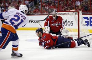 Kyle Okposo beats Phillip Grubauer for a goal in the second period with Brooks Orpik down. AP Photo by Alex Brandon/Getty Images