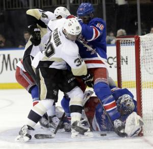 Close Call: The Pens nearly tie it but Marc Staal denies the opportunity in front of Henrik Lundqvist who made the big save on Evgeni Malkin in the second period. AP Photo by Frank Franklin II/Getty Images