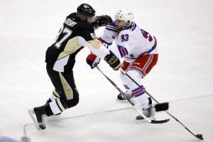 Keith Yandle battles Sidney Crosby during Game 2. AP Photo by Gene J. Puskar/Getty Images