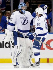 Big Ben Shutout: Lightning goalie Ben Bishop gets congratulated by goalscorer Steven Stamkos following his 26-save shutout in their 2-0 Game 6 shutout win that put the Rangers on the brink.  AP Photo by Frank Franklin II/Getty Images