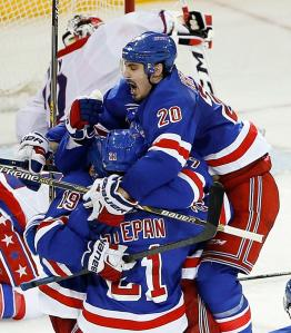 Chris Kreider jumps into the arms of Derek Stepan and teammates after scoring a clutch tying goal with 1:41 left in Game 5. The Rangers stayed alive with Ryan McDonagh providing the overtime winner with Kreider screening in front.  AP Photo by Julie Jacobson/Getty Images
