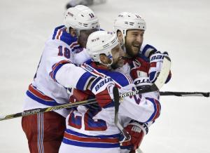 Dan Boyle is congratulated by Marc Staal and Tanner Glass following his big goal that proved to be the winner in the Rangers' hair raising 4-3 win over the Caps to take Game 6. AP Photo by Nick Wass/Getty Images