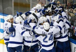 Lights Out: The Lightning celebrate their Game 7 victory advancing to the Stanley Cup Final at a stunned MSG. AP Photo by Frank Franklin II/Getty Images