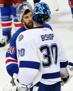 Bishop gets congrats from Lundqvist: A defeated Henrik Lundqvist congrats Ben Bishop following a heartbreaking 2-0 home loss in Game 7.  AP Photo by Kathy Willens/Getty Images