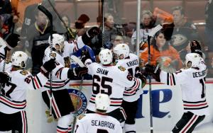 Marcus Kruger is congratulated by happy Hawks after winning the longest game in franchise history. Chicago evened the series with Anaheim prevailing 3-2 in triple overtime. AP Photo by Jae C. Hong/Getty Images