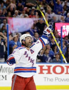 Martin St. Louis finally celebrates a goal scoring on the power play after drawing a high-sticking penalty.  AP Photo by Chris O'Meara/Getty Images
