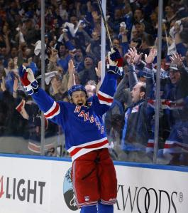 Derek Stepan celebrates his power play goal which cut the deficit to 3-2 in the second period. But a bad penalty at the start of the third proved costly. AP Photo by Kathy Willens/Getty Images