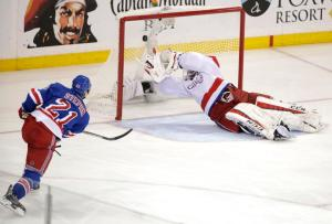 Derek Stepan takes the winning shot to beat a sprawling Braden Holtby scoring at 11:24 of overtime to send the Rangers to the Conference Finals where they'll meet the Lightning. Game 1 is Saturday. AP Photo by Frank Franklin II/Getty Images