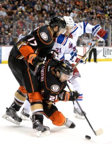 Derek Stepan battles Ryan Kesler last season. He should be rewarded with a similar contract to the extension the Canucks gave Kesler. Getty Images
