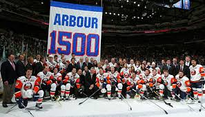 Al Arbour passed away at the age of 82 on Friday. He led the Islanders to four straight Stanley Cups and a sports record 19 consecutive playoff series wins.  usatoday30.com  Getty Images