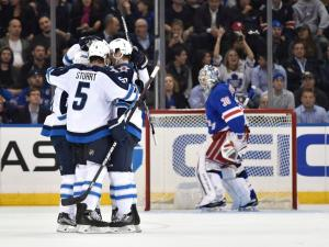 Little Scores: Jets forward Bryan Little scores one of his two goals in Winnipeg's 4-1 win over the Rangers. AP Photo/Kathy Kmonicek/Getty Images