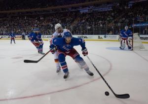 Dan Girardi battles Michael Frolik during the Rangers 4-1 win over the Flames.  AP Photo/Bryan R. Smith/Getty Images