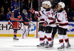 Henrik Lundqvist skates off in disappointment after the Devils beat the Rangers 2-1 in overtime at MSG. AP Photo by Adam Hunger/Getty Images